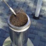 Самый древний метод как прочистить дымоход в бане или доме – это использование специального ершика